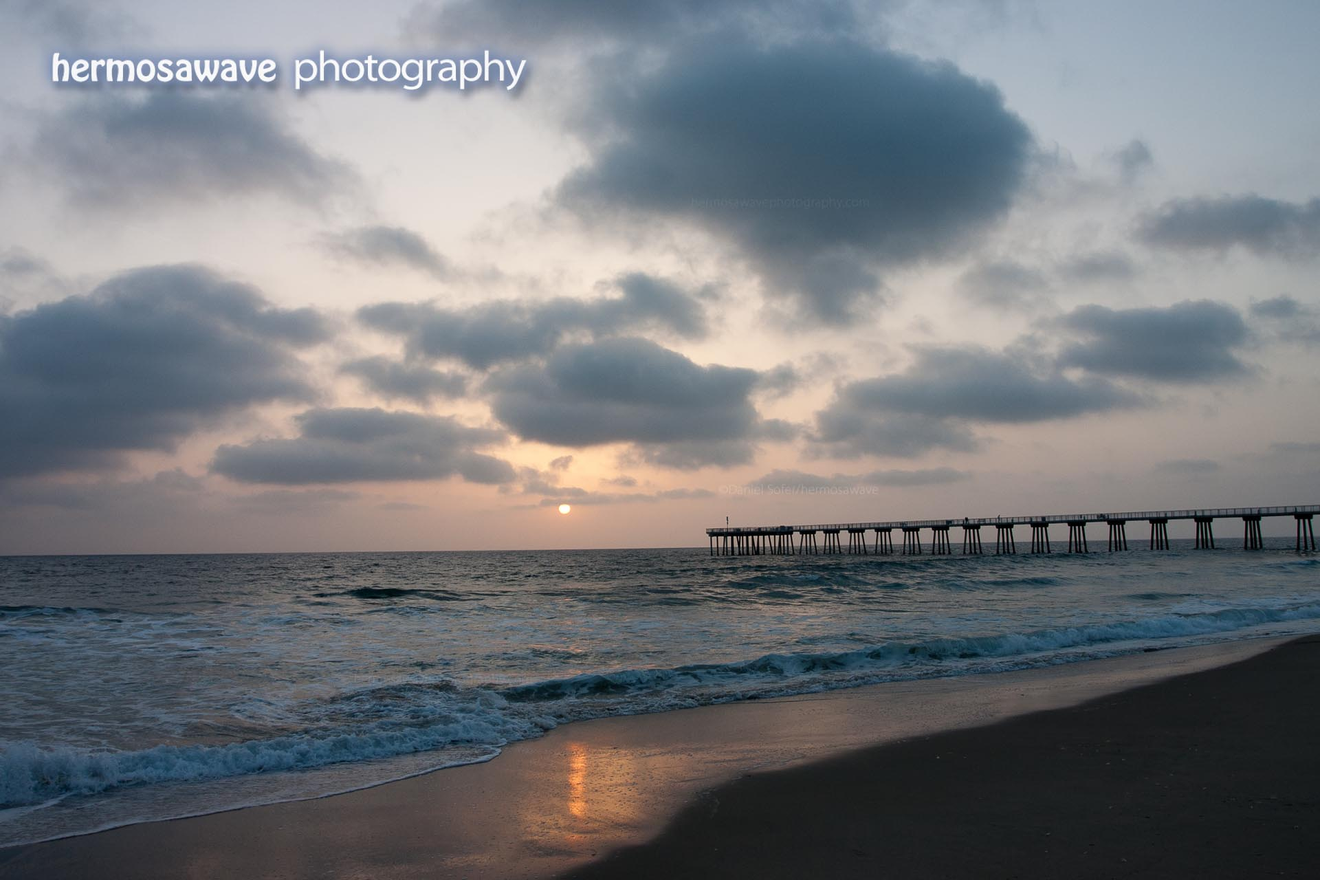 Pier Sunset With Clouds