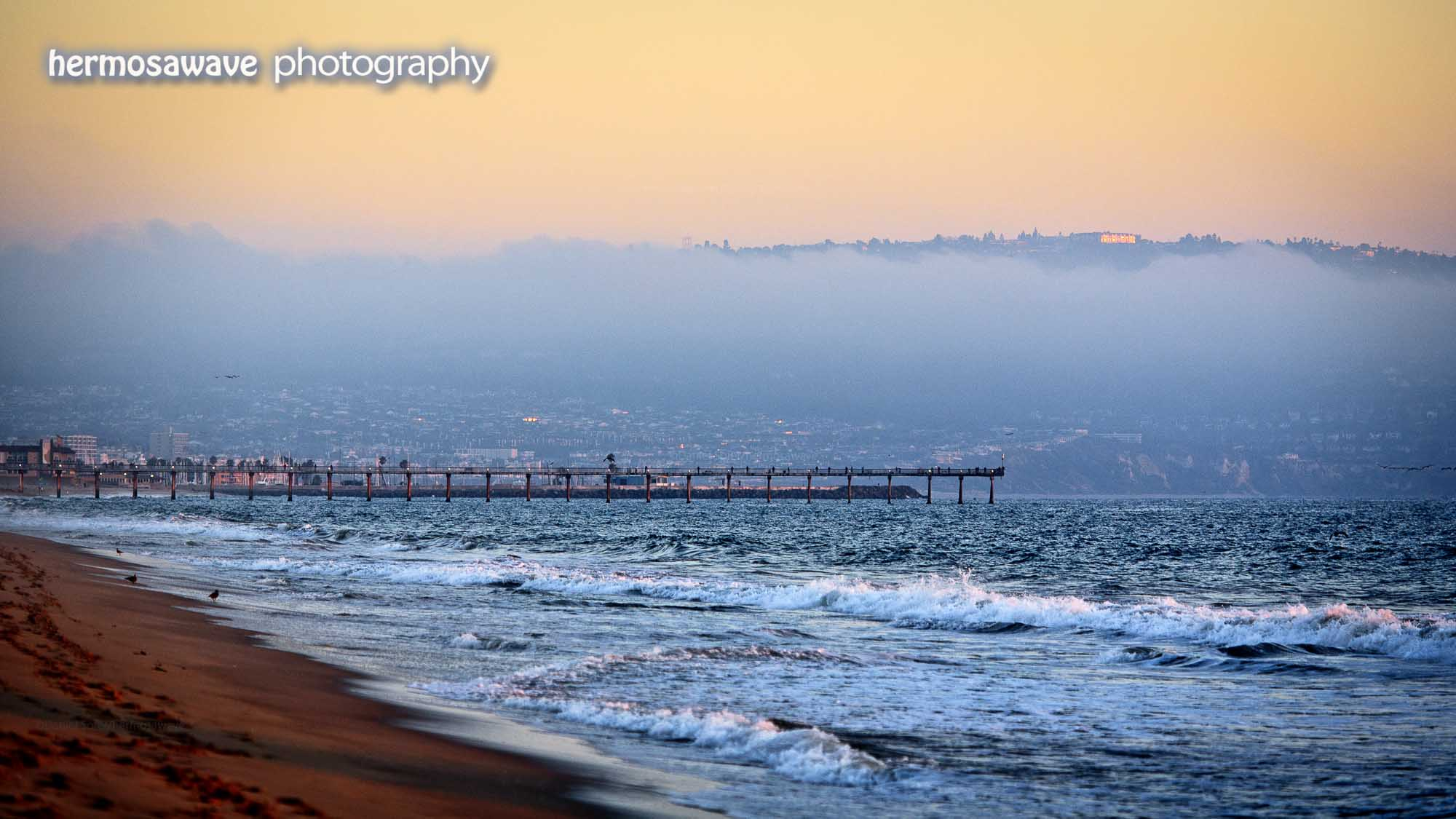 Hills and Fog Above The Pier