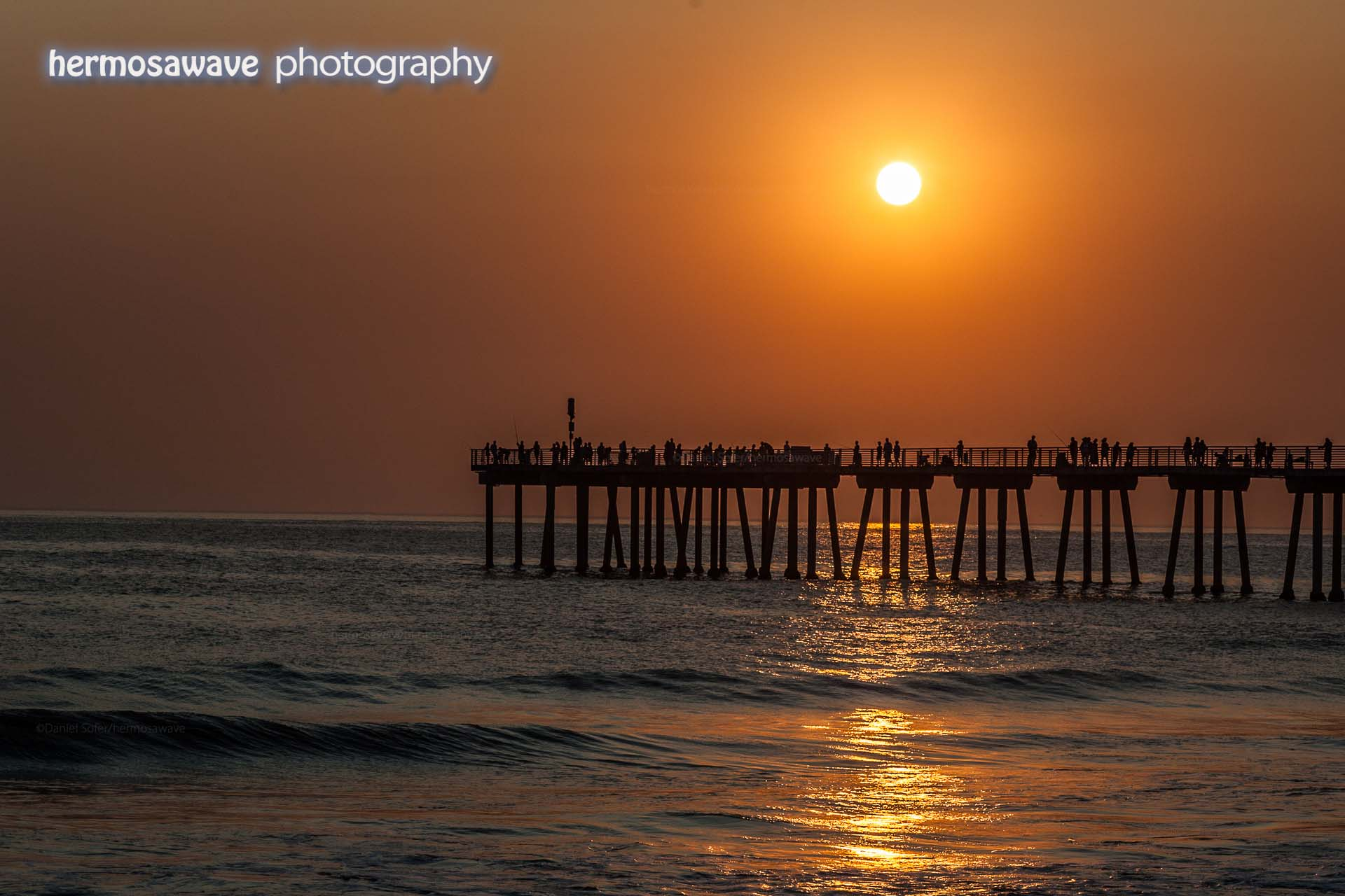 Hazy Sunset Over the Pier